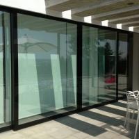 Serramento in legno a vetrata integrale, risparmio energetico ed esclusività nel design